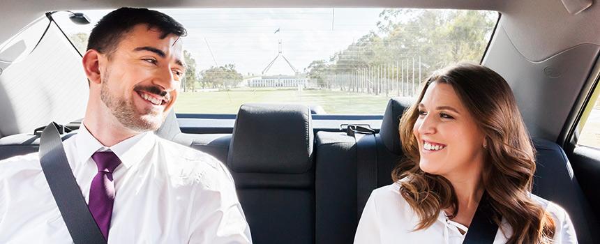 A couple sitting in a Canberra Elite taxi.