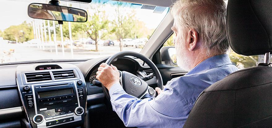 Canberra Elite Taxi driver driving a taxi
