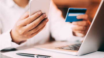 Picture of Woman paying with credit card online
