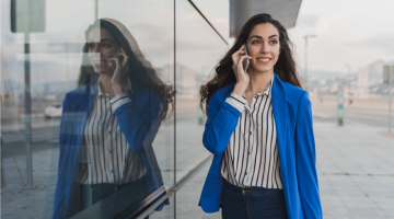 Woman smiling and talking on phone